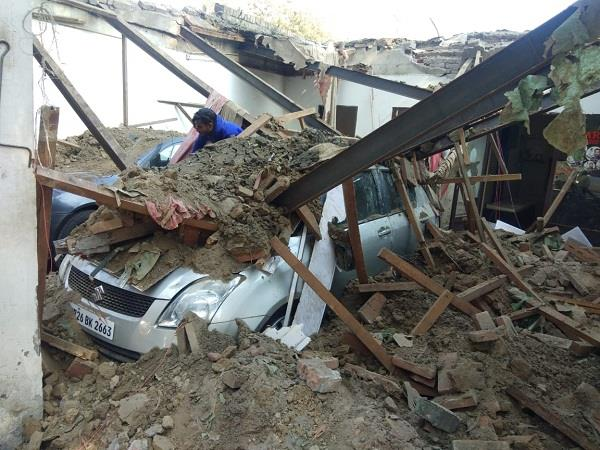2 luxury cars buried in debris due to falling roof