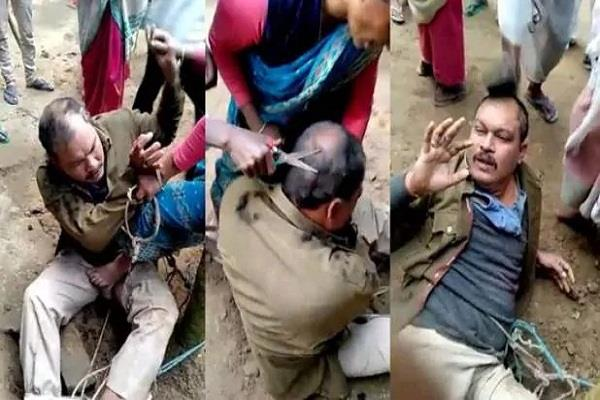 a mob attack on a police team in assam beaten with a tree and chopped hair