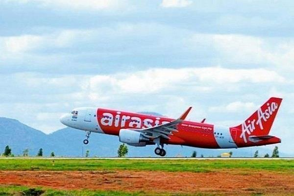 female passenger threatens to blow up with bomb air asia aircraft returned