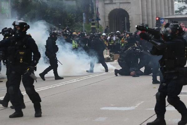 officers beat up after banning hong kong democracy rally