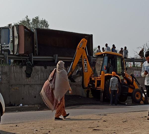sand truck overturns damaged