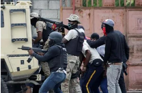 two dead after haitian police attack army hq over