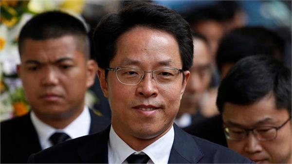 china demotes top official in charge of hong kong official