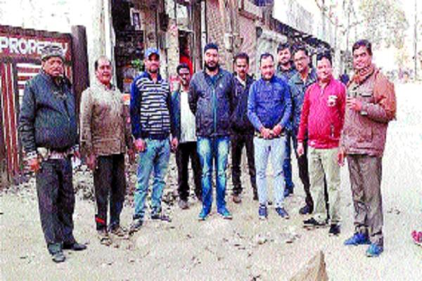 incomplete road work people upset due to business collapse