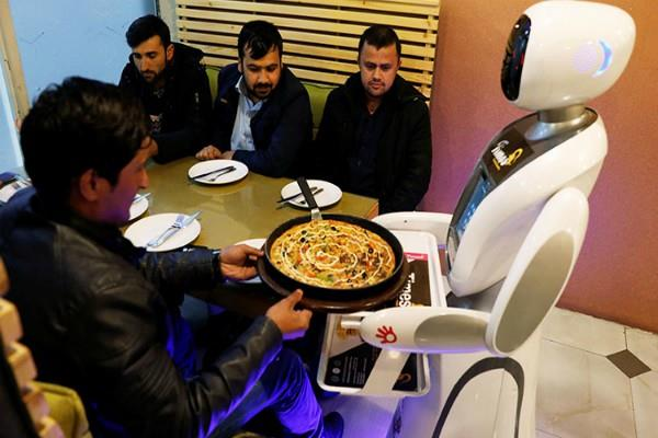 robot waitress serves up food in afghan capital