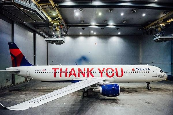 delta salutes its 90 000 strong workforce by painting thank you