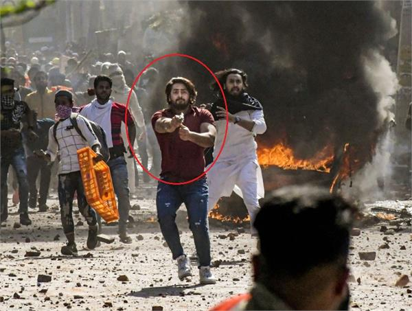 delhi violence identified for firing on policeman
