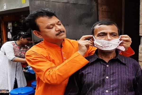 bengal bjp is distributing mask named  modi ji  to avoid corona virus