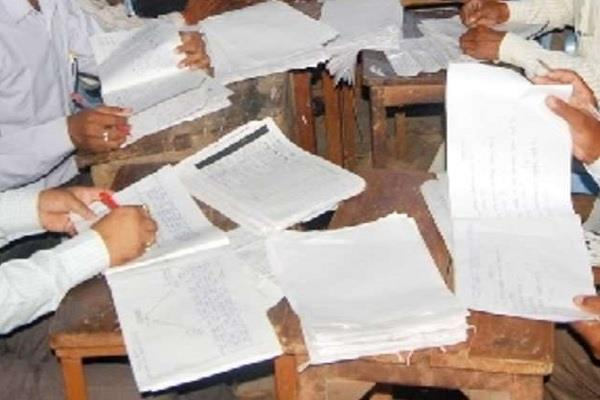 corona outbreak evaluation of answer sheets of up board exam 2020 postponed