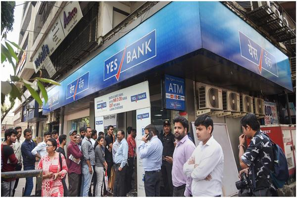 big relief to yes bank customers now can withdraw money from any atm