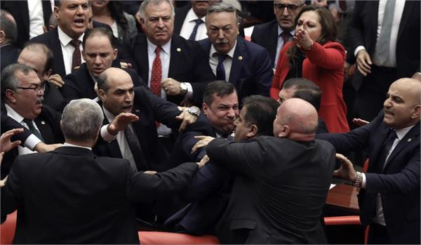 brawl in turkish parliament over military action in syria video viral