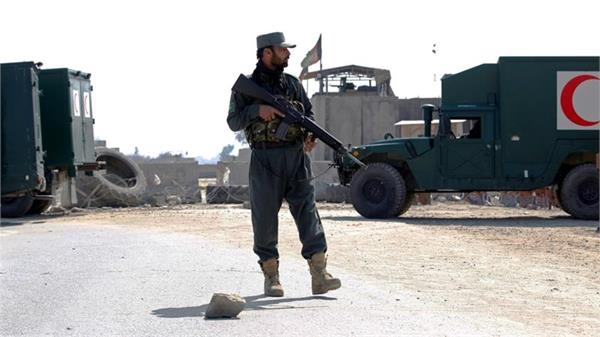 over 20 afghan soldiers police officers killed in taliban attack