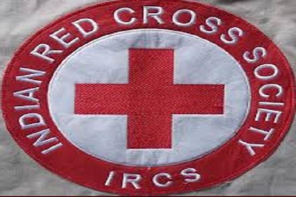 red cross society giving food to the needy
