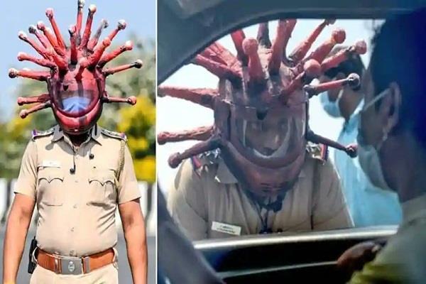chennai cop wears corona helmet to encourage people to stay home