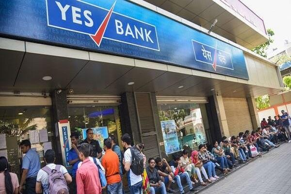 long queues of customers outside yes bank branches