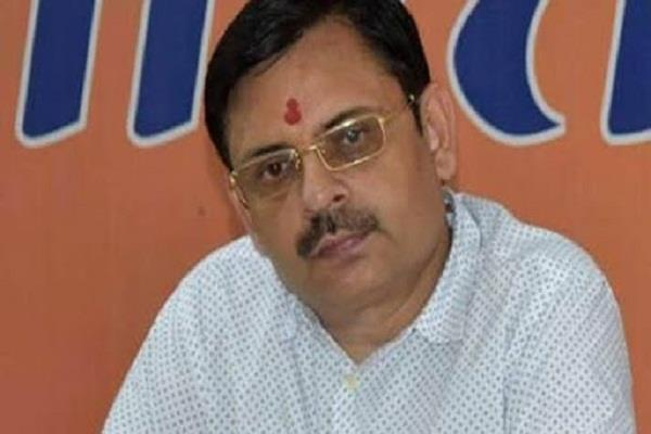 aap leader amanatullah khan defends tahir bjp retaliates