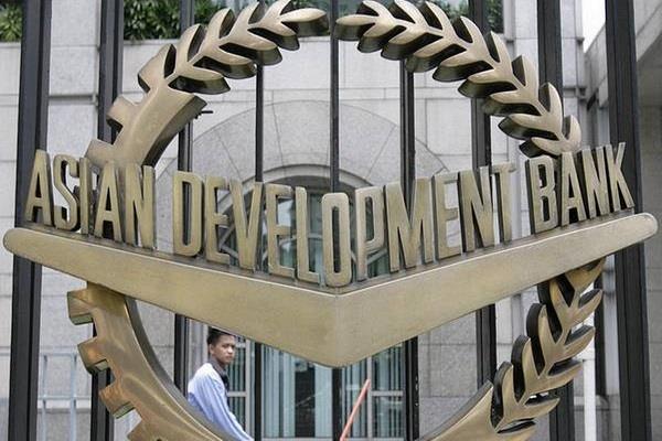 economy hit by kovid 19 adb reduces india s gdp estimate to 4