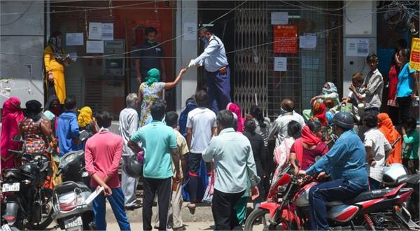 long queues of women engaged to withdraw money outside banks