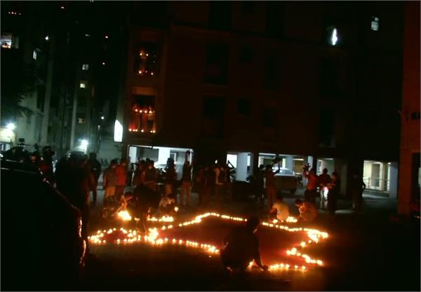 country again united on pm modi s appeal lit lamps for 9 minutes at 9 pm