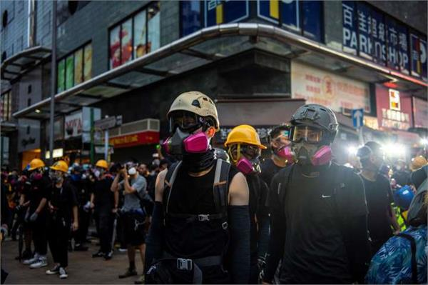 political virus china rounds on hong kong protesters