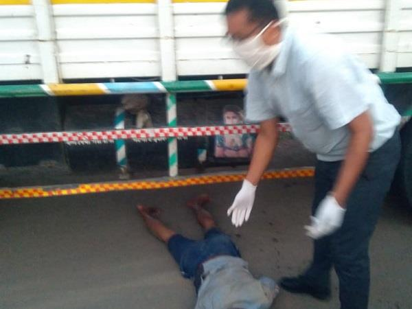 after the accident the bike rider was trapped under the truck