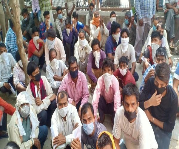 migrant laborers forgot social distancing during screening
