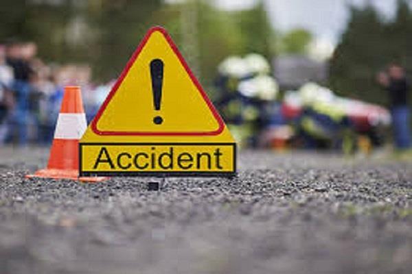 bike rider injured in car and motorcycle collision broken leg