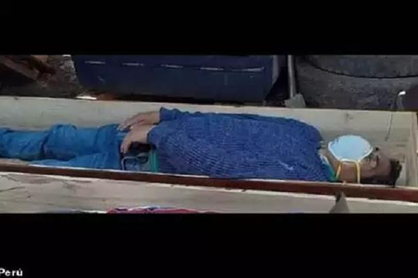 mayor pretends to die from corona lying in coffin to avoid arrest in peru