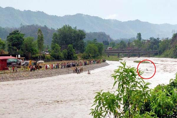 scooty rider stranded in flood of ravine