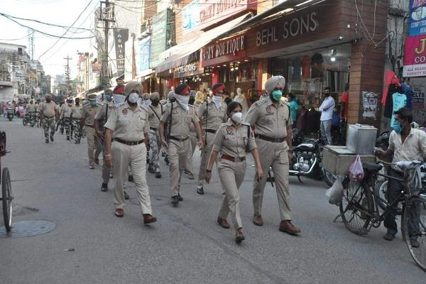 ghallughara day police conduct flag march in congested areas of the city