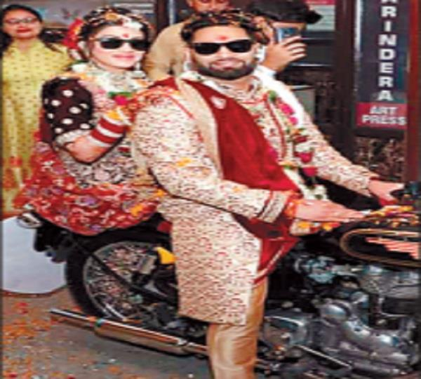 bride on a motorcycle after sustaining social distancing