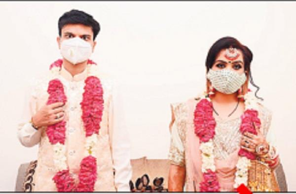 wedding arranged by putting distancing and mask