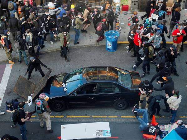 car drives through crowd protester shot in colorado