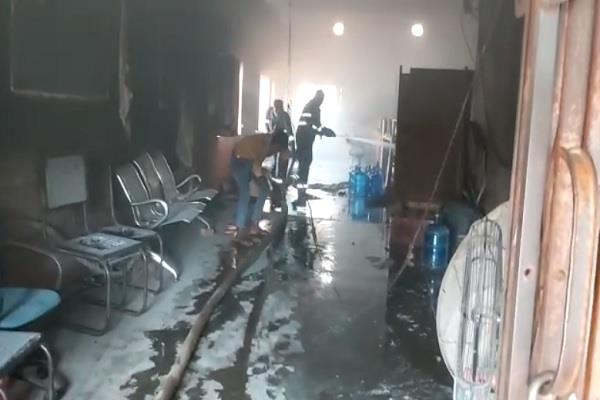 a huge fire caused by a short circuit in the bank burning goods worth millions