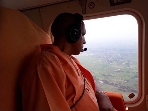 cm yogi did aerial survey of flood affected areas