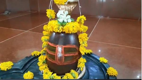 water coming out of shivling devotees gathered to see