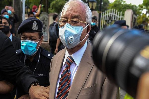 former malaysian pm najib razak sentenced to 12 years in embezzlement case