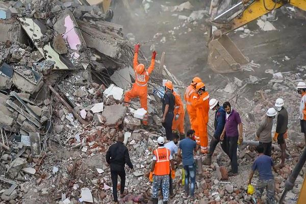 woman taken out alive after 26 hours after building collapses in maharashtra