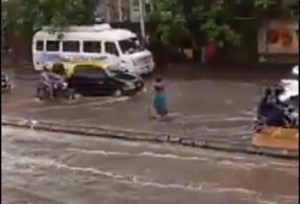 50 year old woman standing on the road for 7 hours in heavy rain