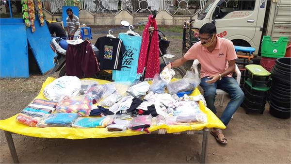 private teacher forced to sell clothes on pavement in barwani