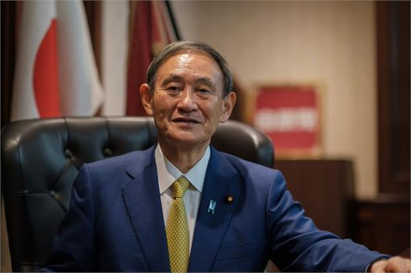 japan s parliament elects yoshihide suga as the new prime minister