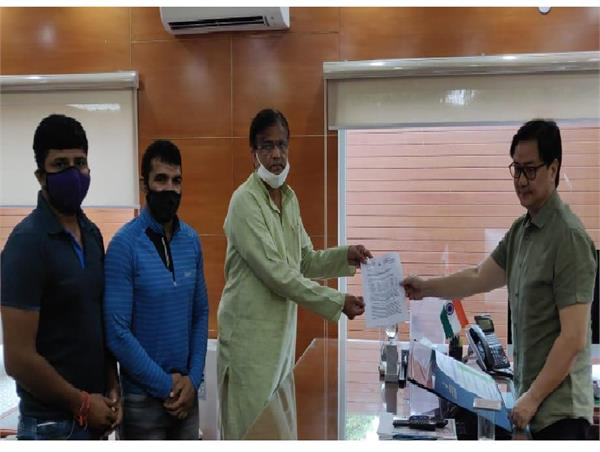 dhankar fulfills promise made to wrestler virendra