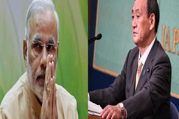 pm modi calls japan prime minister