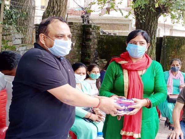 distribute smart phones masks and sanitizers to asha workers