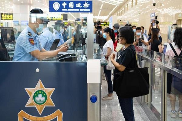 china allows foreigners with valid permits to enter the country from sept 28