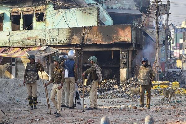 delhi riots names of salman khurshid and prashant bhushan in the charge sheet