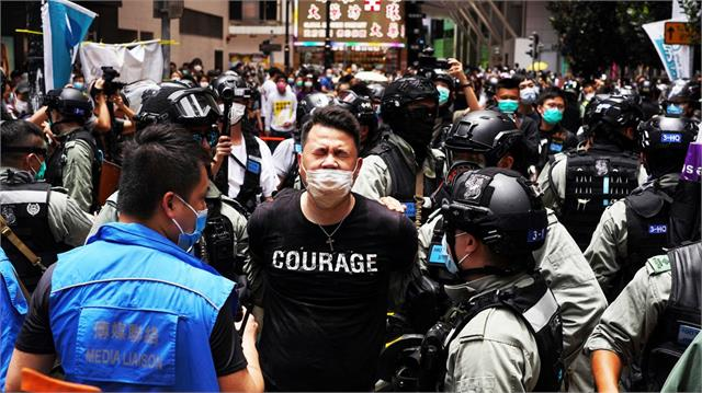 11 people arrested for supporting democracy supporters in hong kong