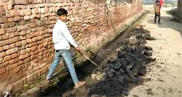 contractor is cleaning the drain with innocent children