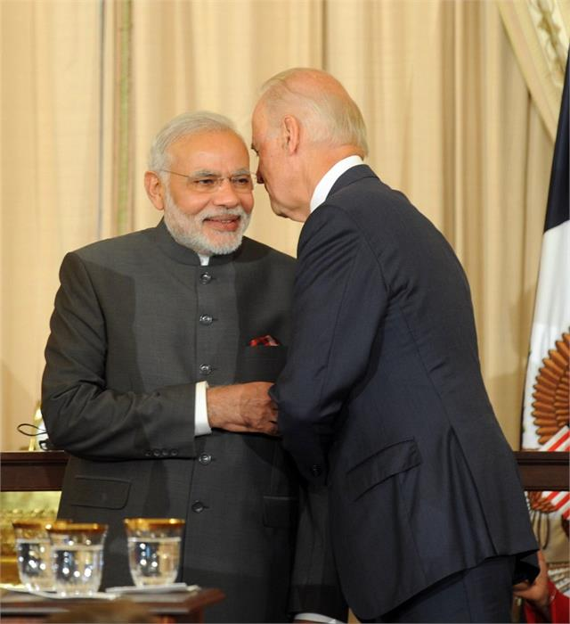 pm modi speaks to biden says  committed to rules based order