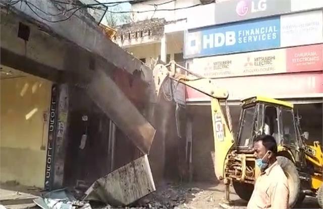 pda bulldozer runs on a large market in prayagraj 2 dozen illegal shops built